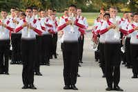 "<p></p><p>Marching band members from Santa Clara Vanguard practice marching drills before they take the field Thursday at C.H. Collins Athletic Complex in Denton. Often referred to as the ""major league of marching band,"" Drum Corps International brings together musicians from across the globe for a summer tour of marching shows.</p><p></p>DRC"